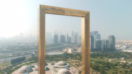 seçkinler : DUBAI, UNITED ARAB EMIRATES - DECEMBER 26, 2019. Aerial view of the skyline as seen through the Dubai Frame shyscraper Stok Video