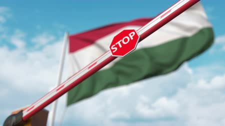 определенный : Closed boom gate on the Hungarian flag background. Restricted entry or certain ban in Hungary
