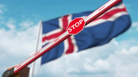 определенный : Closed boom gate on the Icelandic flag background. Restricted entry or certain ban in Iceland