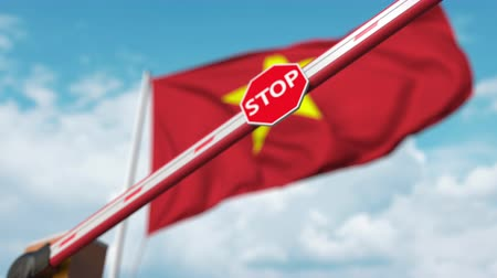 определенный : Closing boom barrier with stop sign against the Vietnamese flag. Restricted entry or certain ban in Vietnam Стоковые видеозаписи