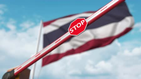 определенный : Closing boom barrier with stop sign against the Thai flag. Restricted border crossing or certain ban in Thailand