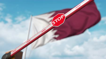 определенный : Barrier gate being closed with flag of Qatar as a background. Qatari restricted entry or certain ban Стоковые видеозаписи