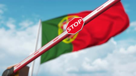 определенный : Closed boom gate on the Portuguese flag background. Restricted entry or certain ban in Portugal