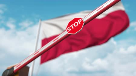 определенный : Closed boom gate on the Polish flag background. Restricted entry or certain ban in Poland