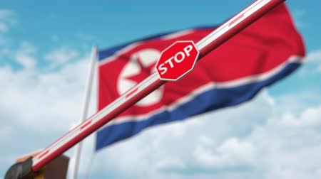 dprk : Closed boom gate on the North Korean flag background. Restricted entry or certain ban in North Korea