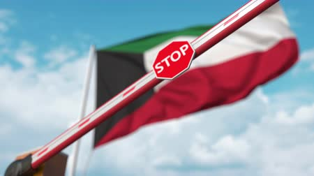 определенный : Closing boom barrier with stop sign against the Kuwaiti flag. Restricted border crossing or certain ban in Kuwait Стоковые видеозаписи