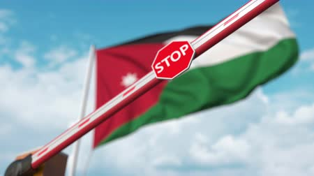 Иордания : Barrier gate being closed with flag of Jordan as a background. Jordanian restricted border crossing or certain ban