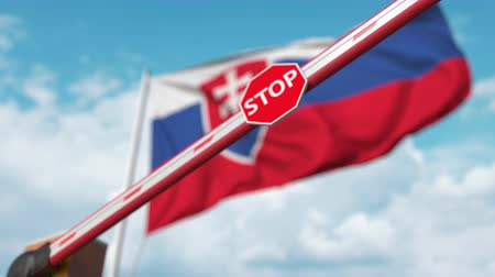 определенный : Closing boom barrier with stop sign against the Slovak flag. Restricted border crossing or certain ban in Slovakia Стоковые видеозаписи