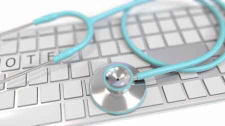 telemedicine : Stethoscope on keyboard with REMOTE text on keys. Telemedicine related conceptual 3D animation Stock Footage