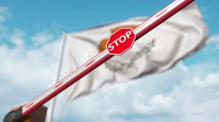 определенный : Closing boom barrier with stop sign against the Cypriot flag. Restricted entry or certain ban in Cyprus
