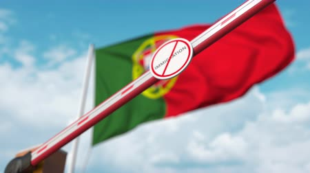 göçmen : Closed boom gate with no immigration sign on the Portuguese flag background. Border closure or immigration ban in Portugal