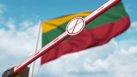 flag of lithuania : Closing boom barrier with stop immigration sign against the Lithuanian flag. Restricted border crossing or immigration ban in Lithuania