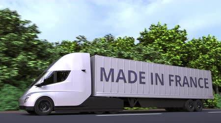 forwarding : Modern electric semi-trailer truck with MADE IN FRANCE text on the side. French import or export related loopable 3D animation