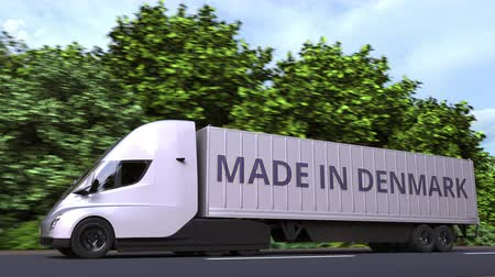 danimarka : Modern electric semi-trailer truck with MADE IN DENMARK text on the side. Danish import or export related loopable 3D animation Stok Video