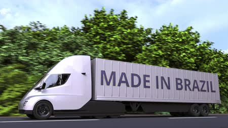 brazilian : Modern electric semi-trailer truck with MADE IN BRAZIL text on the side. Brazilian import or export related loopable 3D animation