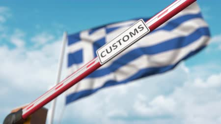 義務 : Closed boom gate with CUSTOMS sign on the Greek flag background. Border closure or protective tariffs in Greece