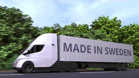 İsveççe : Trailer truck with MADE IN SWEDEN text on the side. Swedish import or export related loopable 3D animation