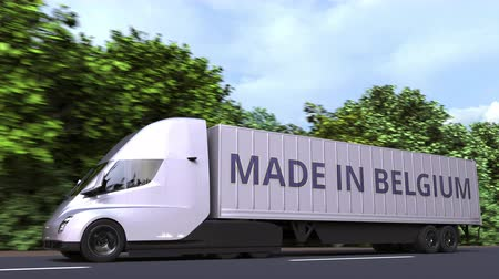 belgie : Trailer truck with MADE IN BELGIUM text on the side. Belgian import or export related loopable 3D animation