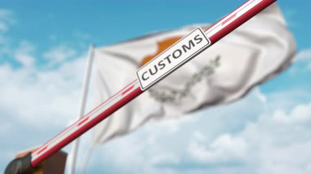 encerramento : Closing boom barrier with CUSTOMS sign against the Cypriot flag. Border closure or protective tariffs in Cyprus