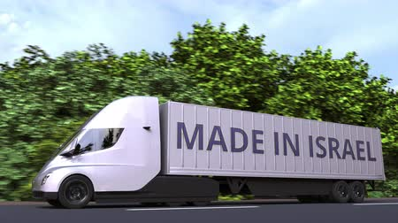 izrael : Modern electric semi-trailer truck with MADE IN ISRAEL text on the side. Israeli import or export related loopable 3D animation Stock mozgókép