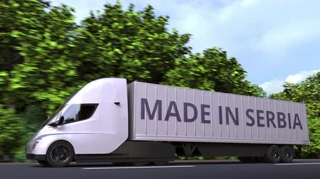 sérvia : Modern electric semi-trailer truck with MADE IN SERBIA text on the side. Serbian import or export related loopable 3D animation Vídeos