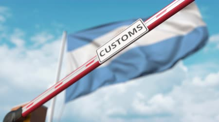 kural : Closed boom gate with CUSTOMS sign on the Argentinean flag background. Border closure or protective tariffs in Argentina