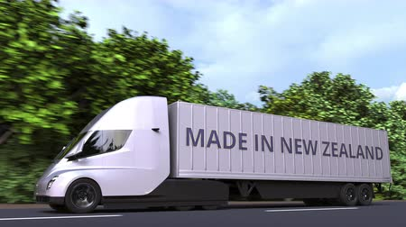 nový zéland : Trailer truck with MADE IN NEW ZEALAND text on the side. Import or export Loopable 3D animation