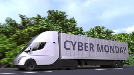 bajo coste : Modern electric semi-trailer truck with CYBER MONDAY text on the side. Loopable 3D animation Archivo de Video