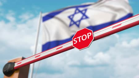 invite : Open boom gate on the Israeli flag background. Free border crossing or lifting a ban in Israel Stock Footage
