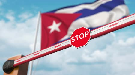invite : Opening boom barrier with stop sign against the Cuban flag. Free entry or lifting a ban in Cuba