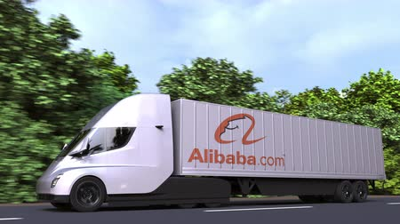 rakomány : Electric semi-trailer truck with ALIBABA GROUP logo on the side. Editorial loopable 3D animation