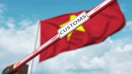 devoir : Closing boom barrier with CUSTOMS sign against the Vietnamese flag. Border closure or protective tariffs in Vietnam