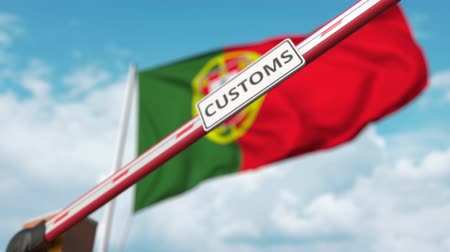 devoir : Closed boom gate with CUSTOMS sign on the Portuguese flag background. Border closure or protective tariffs in Portugal
