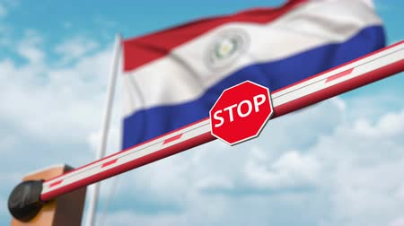 enable : Barrier gate being opened with flag of Paraguay as a background. Paraguayan Free entry or lifting a ban