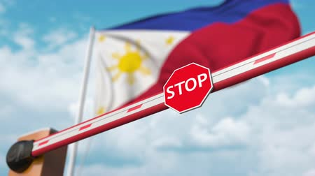 invite : Barrier gate being opened with flag of Philippines as a background. Philippines Free entry or lifting a ban Stock Footage
