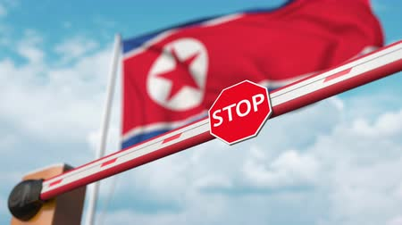 dprk : Open boom gate on the North Korean flag background. Free entry or lifting a ban in North Korea