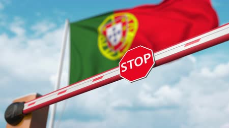 tilalom : Open boom gate on the Portuguese flag background. Free entry or lifting a ban in Portugal
