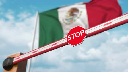 invite : Opening boom barrier with stop sign against the Mexican flag. Free border crossing or lifting a ban in Mexico