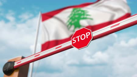invite : Opening boom barrier with stop sign against the Lebanonese flag. Free border crossing or lifting a ban in Lebanon
