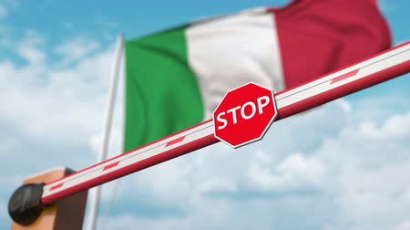 immigratie : Opening boom barrier with stop sign against the Italian flag. Free border crossing or lifting a ban in Italy