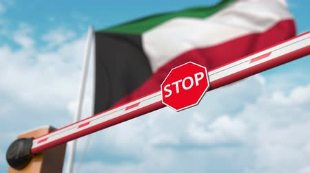 authorise : Opening boom barrier with stop sign against the Kuwaiti flag. Free border crossing or lifting a ban in Kuwait