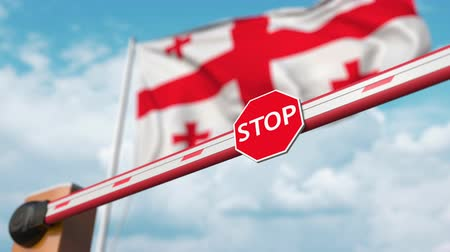 enable : Opening boom barrier with stop sign against the Georgian flag. Free entry or lifting a ban in Georgia
