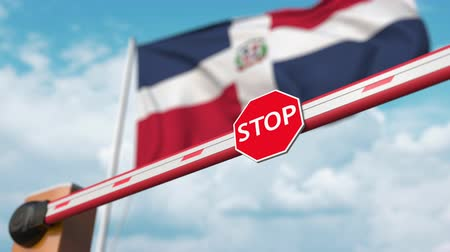 accepting : Open boom gate on the Dominican flag background. Free entry or lifting a ban in the Dominican Republic Stock Footage
