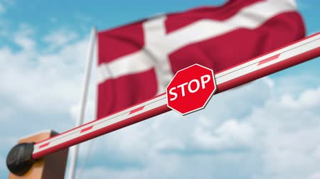 danimarka : Open boom gate on the Danish flag background. Free entry or lifting a ban in Denmark