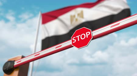 authorise : Opening boom barrier with stop sign against the Egyptian flag. Free entry or lifting a ban in Egypt Stock Footage