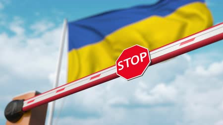 authorise : Barrier gate being opened with flag of Ukraine as a background. Ukrainian Free border crossing or lifting a ban