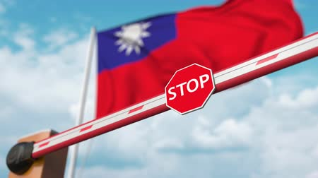 authorise : Barrier gate being opened with flag of Taiwan as a background. Taiwanese Free border crossing or lifting a ban Stock Footage