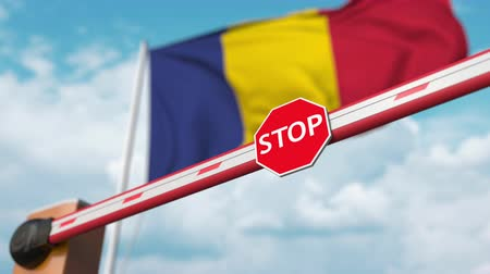 romeno : Open boom gate on the Romanian flag background. Free entry or lifting a ban in Romania