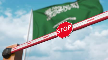 abriu : Open boom gate on the Saudi flag background. Free entry or lifting a ban in Saudi arabia