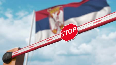 sérvia : Opening boom barrier with stop sign against the Serbian flag. Free border crossing or lifting a ban in Serbia Vídeos